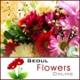 Present your mother a gift of classic arrangement of flowers